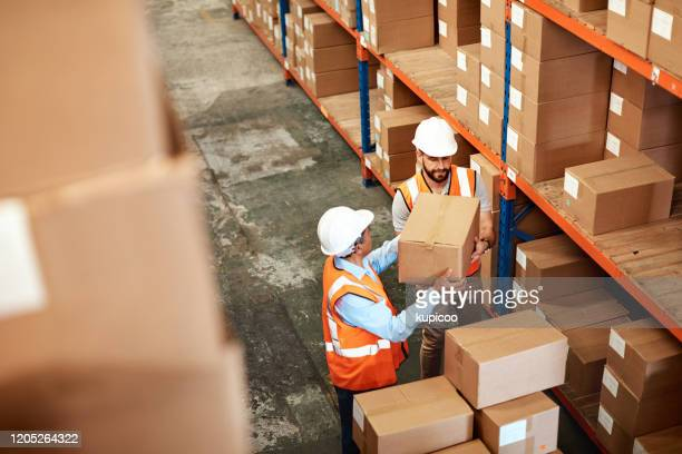 organising the shipping station - picking up stock pictures, royalty-free photos & images