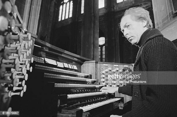 Organist Jean Guillou performs at St Eustache during the Paris est une Fete television show Guillou who has written symphonies and concerts was...