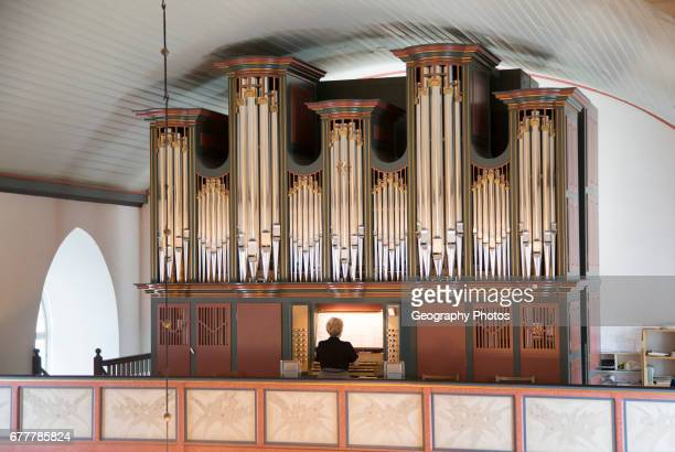 Organist playing inside Bronnoy Church Bronnoysund Nordland Norway built in 1870