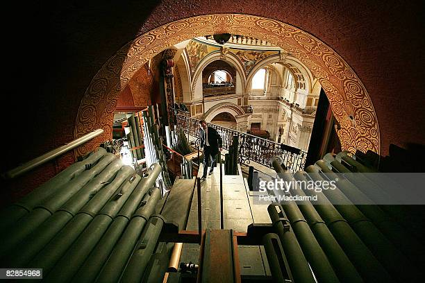 Organist Simon Johnson inspects the pipes of the recently restored Dome Organ in St Paul's Cathedral on September 17 2008 in London The Grand Organ...