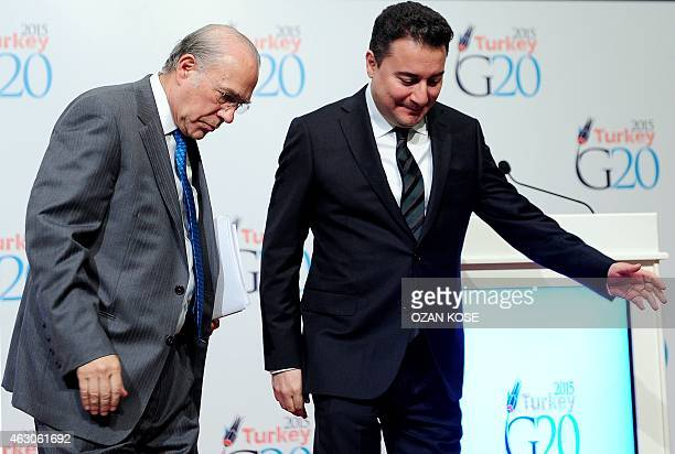 Organization for Economic Cooperation and Development Secretary General Angel Gurria and Turkey's Deputy Prime Minister Ali Babacan chat as they...
