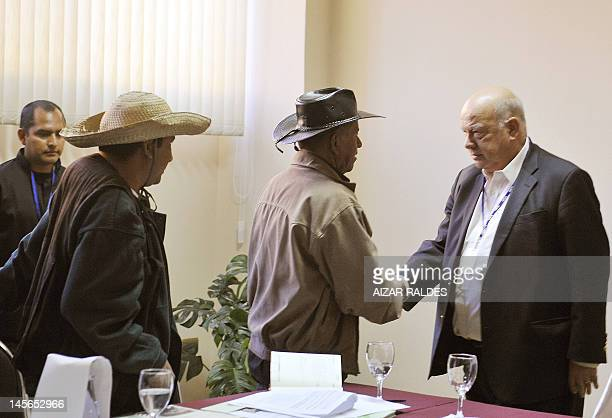 Organization of American States Secretary General, Jose Miguel Insulza , greets indigenous leaders from the Bolivian Amazons Fernando Vragas and...