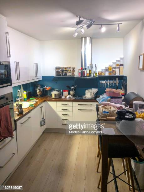 organized chaos in a modern kitchen in oslo, norway - vertical stock pictures, royalty-free photos & images