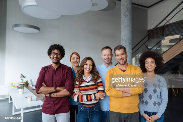 Organized group photo of successful business people at work