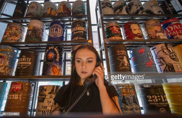 Organizer Anastasiia Sulchovii works the front desk which has a wall of beer choices The Craft Beer Market recently opened at 1 Adelaide Street East...