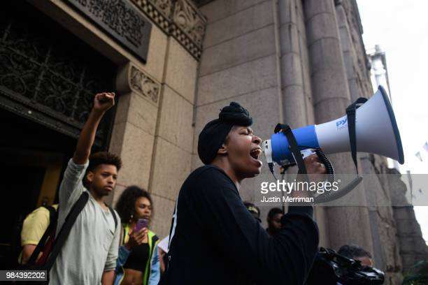 Organizer Nicky Jo Dawson leads a protest a day after the funeral of Antwon Rose II on June 26 2018 on the steps of the Allegheny County Courthouse...