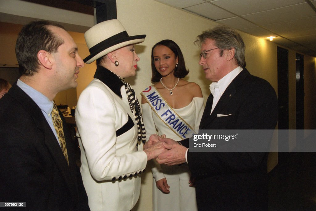 Genevieve de fontenay alain delon and miss france pictures getty organizer of the miss france pageant genevieve de fontenay and actor alain delon greet each other m4hsunfo
