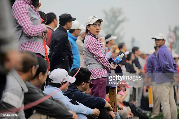 Organizers and golf fans watch the play during the third round of the Reignwood LPGA Classic at Pine Valley Golf Club on October 5 2013 in Beijing...