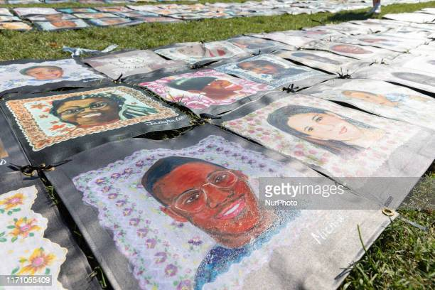 Organizers from Saint Sabina Church from Chicago show a flag with pictures of people victims of gun violence during a demonstration outside the...