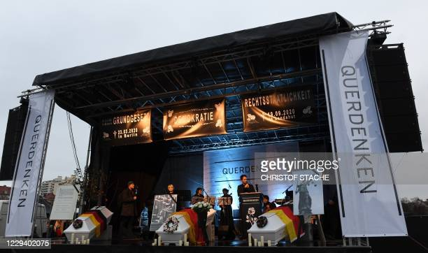 Organizers of a demonstration against the coronavirus Covid-19 restrictions hold a symbolic church service on the stage at the Theresienwiese in...