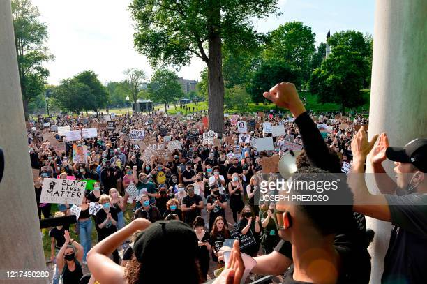 "Organizers rally the people who attended a ""Black Lives Matter"" rally and march at Boston Common, in response to the death of George Floyd and other..."