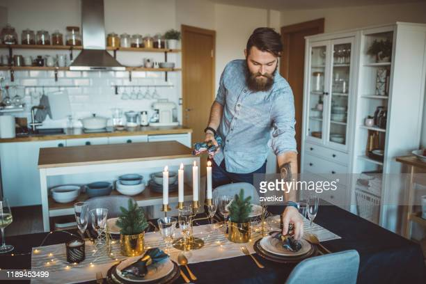 organizing christmas dinner - preparation stock pictures, royalty-free photos & images