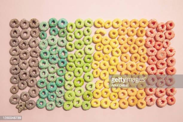 organizing colorful cereals with rainbow colors flag in creative picture at home. - bisexuality fotografías e imágenes de stock