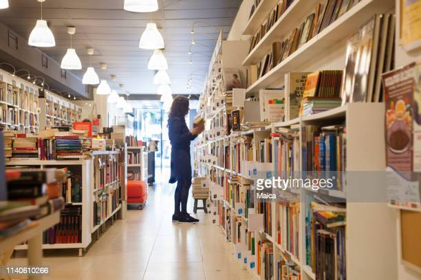 organizing the shelf in the bookstore - book shop stock pictures, royalty-free photos & images