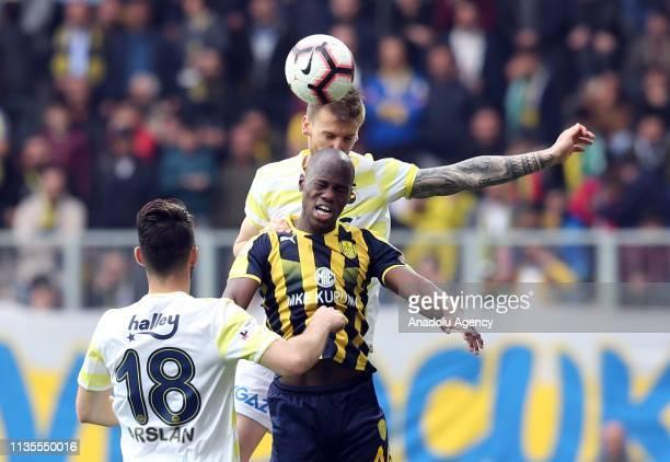 Orgill of MKE Ankaragucu in action against Serdar Aziz of Fenerbahce during Turkish Super Lig soccer match between MKE Ankaragucu and Fenerbahce at...