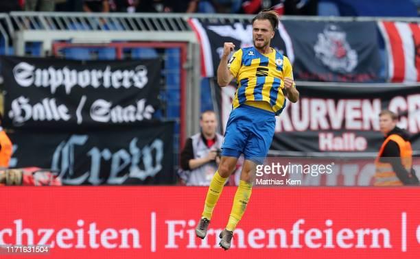 Orhan Ademi of Braunschweig celebrates after scoring his team's first goal during the 3 Liga match between Eintracht Braunschweig and Hallescher FC...