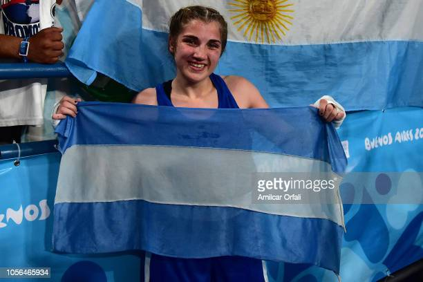 Oriana Saputo of Argentina celebrates her victory in Women's Light Bronze Medal Bout during day 12 of Buenos Aires 2018 Youth Olympic Games at...