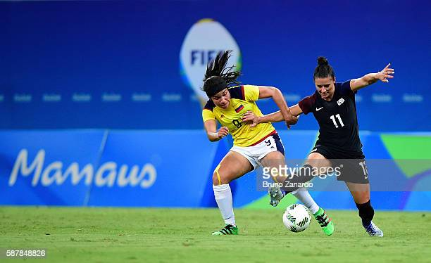 Orianica Velasquez of Colombia and Ali Krieger of the United States vie for the ball in the second half of the Women's Football First Round Group G...