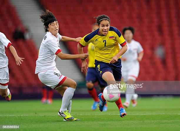 Orianica Velasquez of Colombia and Myong Hwa Jon of DPR Korea in action during the womens Group G football match between Colombia and DPR Korea as...
