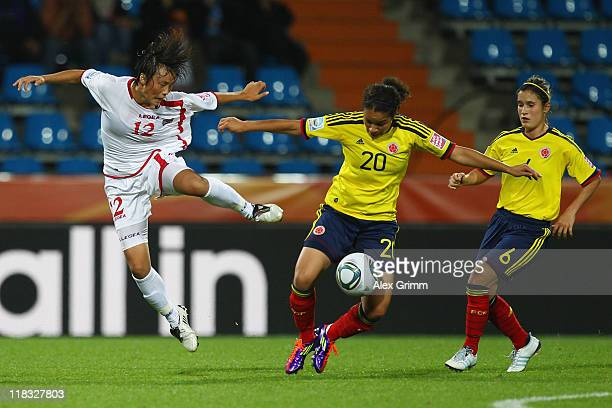 Orianica Velasquez of Colombia is challenged by Jon Myong Hwa of Korea DPR during the FIFA Women's World Cup 2011 Group C match between Korea DPR and...