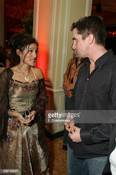 Q'Orianka Kilcher and Christian Bale during New Line Cinema Los Angeles Premiere of 'The New World' at Academy of Motion Pictures Arts and Sciences...