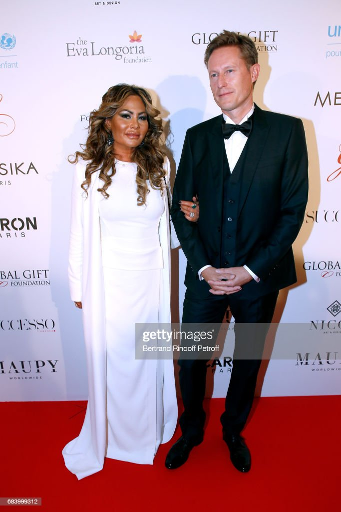 Orianne Collins and guest attend the 'Global Gift, the Eva Foundation' Gala : Photocall at Hotel George V on May 16, 2017 in Paris, France.