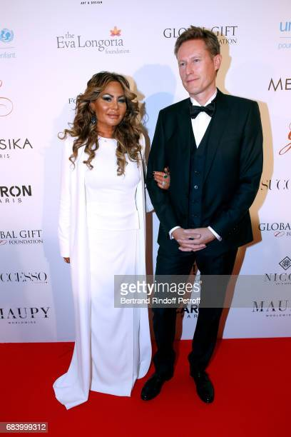 Orianne Collins and guest attend the Global Gift the Eva Foundation Gala Photocall at Hotel George V on May 16 2017 in Paris France