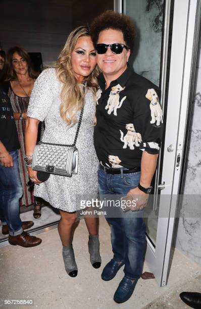 Orianne Collins and Romero Britto attend Orianne Collins Jewellery Grand Opening on May 10 2018 in Miami Florida