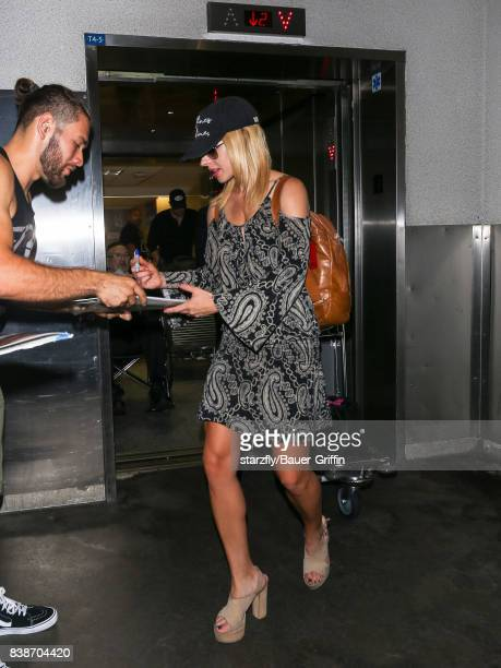 Orianthi Panagaris is seen at Los Angeles International Airport on August 24 2017 in Los Angeles California
