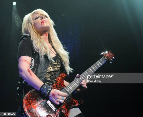Orianthi performs with Alice Cooper at the Cobb Energy Center on December 13 2011 in Atlanta Georgia