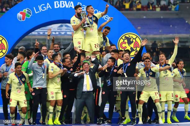 Oribe Peralta and Paul Aguilar of America celebrate with teamates the championship trophy during the final second leg match between Cruz Azul and...