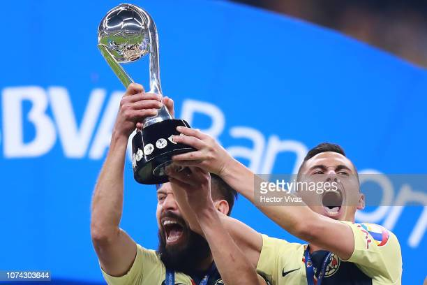 Oribe Peralta and Paul Aguilar of America lift the Championship Trophy after the final second leg match between Cruz Azul and America as part of the...