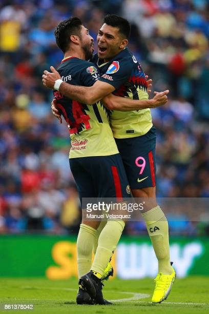 Oribe Peralta and Silvio Romero of America celebrate the second goal of their team during the 13th round match between Cruz Azul and America as part...