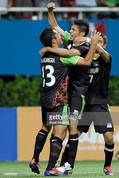 Oribe Peralta and teammtes of Mexico celebrate a scored goal againist Ecuador during a match as part of XVI Pan American Games at Ominilife stadium...