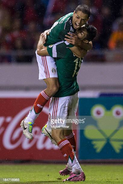 Oribe Peralta celebrates after scoring during a match between Costa Rica and Mexico as part of the CONCACAF Qualifiers at National Stadium on October...