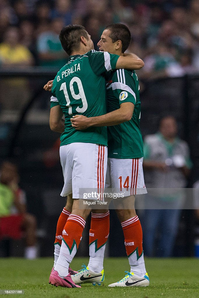 Oribe Peralta celebrates after scoring with teammate Javier Hernandez during a match between Mexico and Panama as part of the CONCACAF Qualifyers at Azteca stadium on October 11, 2013 in Mexico City, Mexico.