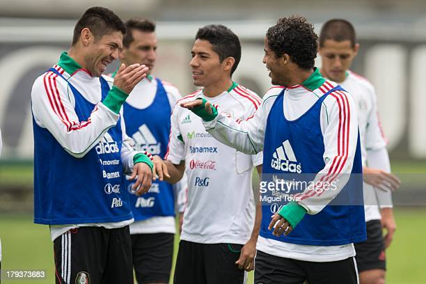 Oribe Peralta jokes with Giovani Dos Santos during a training session before a World Cup qualifier match against Honduras on September 02 2013 in...