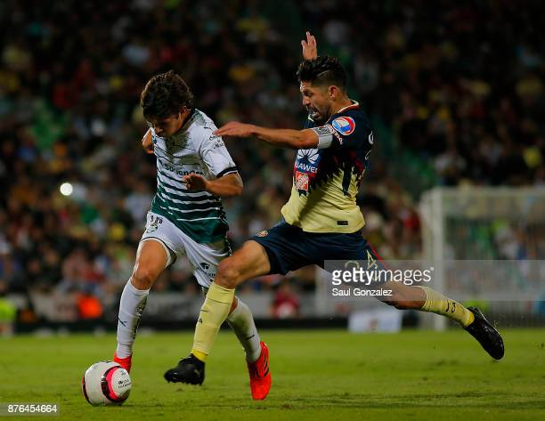 Oribe Peralta of America and Ulises Rivas of Santos fight for the ball during the 17th round match between Santos Laguna and America as part of the...