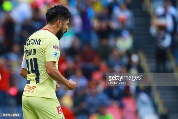 Oribe Peralta of America celebrate with teammates after scoring the first goal of his team during the 7th round match between America and Pumas UNAM...