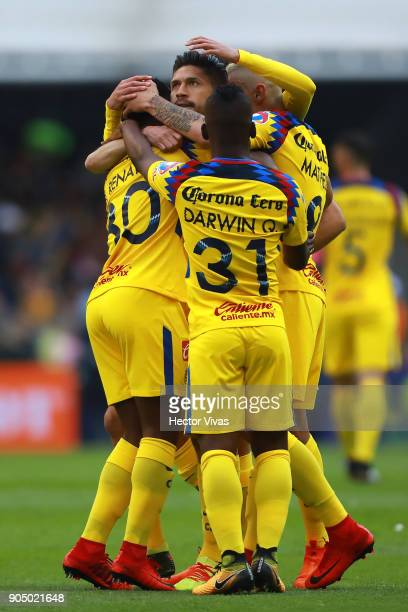 Oribe Peralta of America celebrate with teammates after scoring the first goal of his team during the second round match between America and Pachuca...