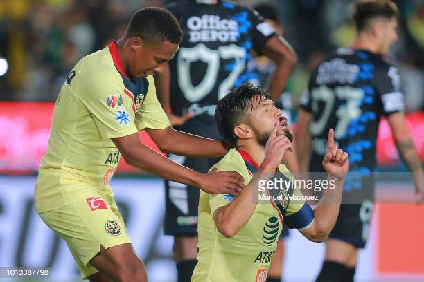 Oribe Peralta of America celebrates a scored goal with Andres Ibarguen of America during the third round match between Pachuca and Club America as...