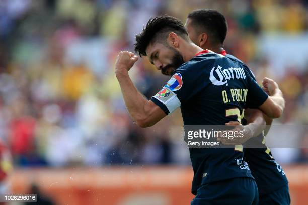 Oribe Peralta of America celebrates after scoring the first goal of his team during the 8th round match between Lobos BUAP and America as part of the...