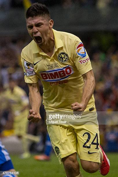 Oribe Peralta of America celebrates after scoring the first goal of his team during a Championship first leg match between America and Montreal...
