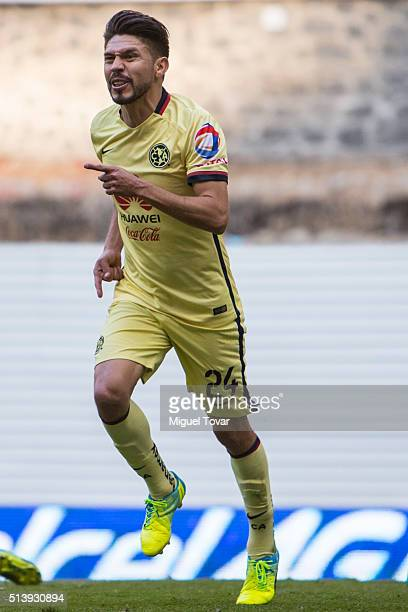 Oribe Peralta of America celebrates after scoring the first goal of his team during the 9th round match between America and Morelia as part of the...