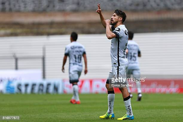 Oribe Peralta of America celebrates after scoring the first goal of his team during the 11th round match between America and Leon as part of the...