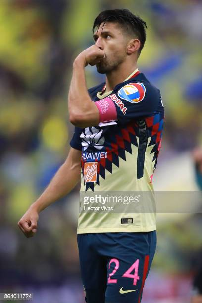 Oribe Peralta of America celebrates after scoring the first goal of his team during the 10th round match between America and Chivas as part of the...