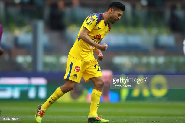 Oribe Peralta of America celebrates after scoring the first goal of his team during the second round match between America and Pachuca as part of the...