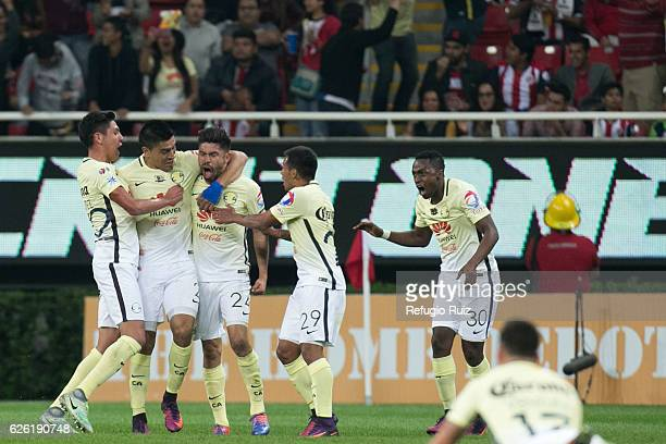 Oribe Peralta of America celebrates after scoring the fist goal of the game during the quarter finals second leg match between Chivas and America as...