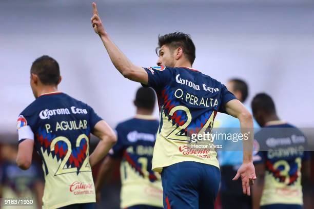 Oribe Peralta of America celebrates after scoring the fourth goal of his team during the 7th round match between America and Monarcas as part of the...