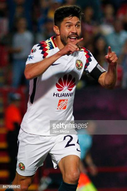 Oribe Peralta of America celebrates after scoring the opening goal during the 9th round match between Tijuana and America as part of the Torneo...